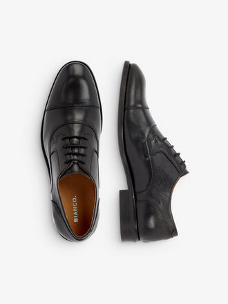 DRESS DERBIES EN CUIR